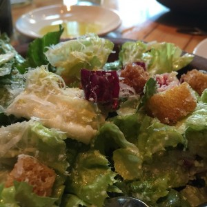 The best Caesar salad ever is at @pratowp. Olive oil…