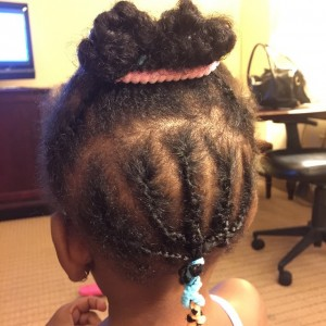 Not quite twists. Not really cornrows but mama is doing…
