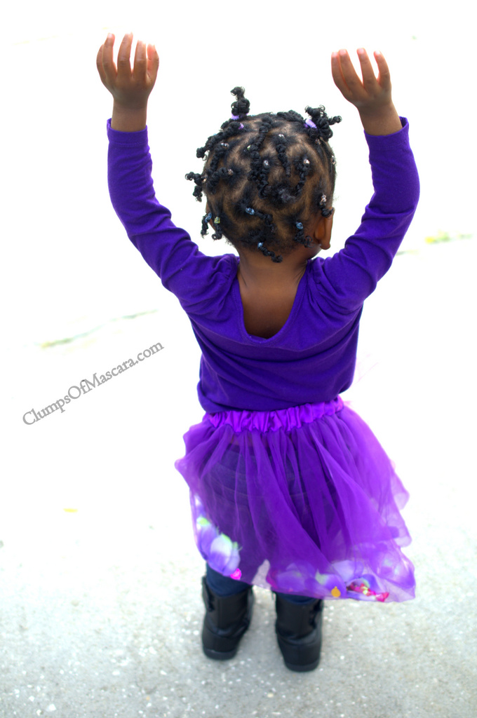 Toddler in purple tutu