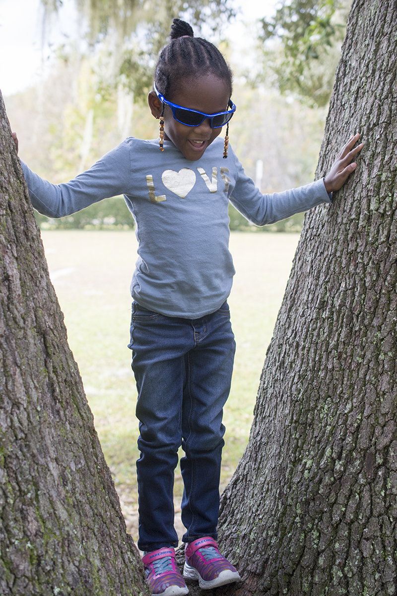 girl climbs tree